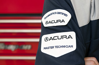 Acura patches on technician's sleeve - Diagnostics Certified and Master Technician
